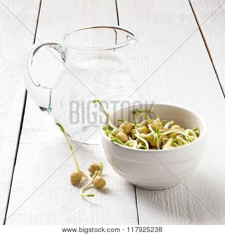Sprouted Chickpeas And A Jug Of Spring Water For Cooking Healthy Food