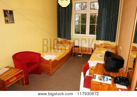 Room With Table And Bed.