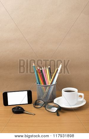coffee phone eyeglasses color pencil and car key on wood table background