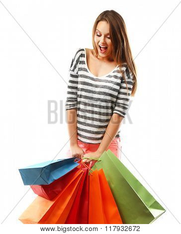Young pretty woman with shopping packages isolated on white