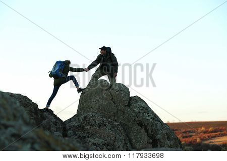 Man and woman climbing the mountain
