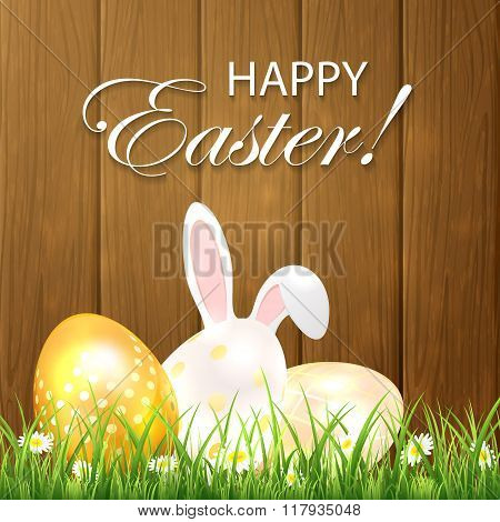 Easter Background With Eggs And Rabbit On Wooden Background