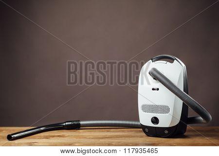 vacuum cleaner on parquet floor