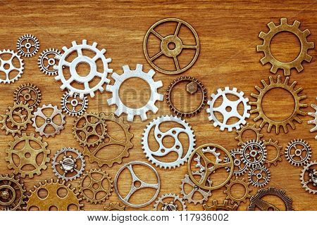 vintage gear wheels on wooden background