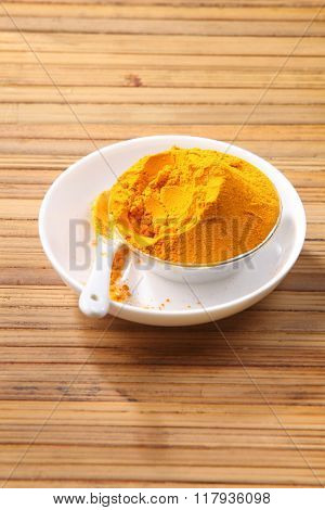turmeric powder on the bamboo background