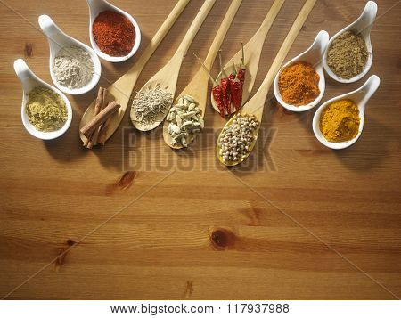 assorted curry powder and spices on the wooden  background