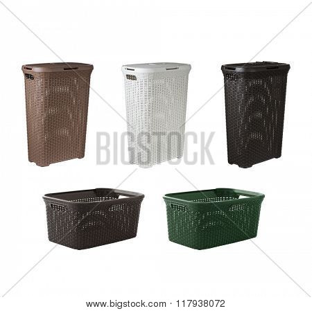 Collage of various plastic baskets for dirty clothes, isolated on white