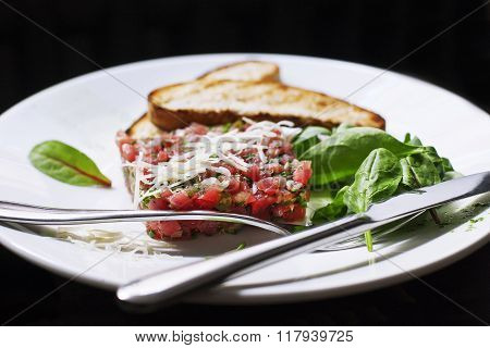Tartare of beef with spinach.