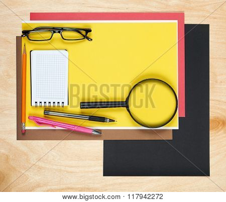 Flat lay office tools and supplies. Flat design and top view of workspace, workplace on desk. Stationery on wood background.