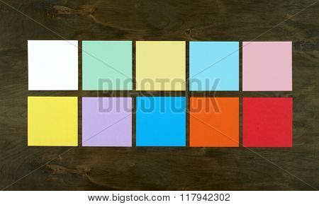 Flat lay color bar from paper on wood background. Flat design and top view of interface concept on desk.