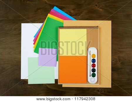 Flat lay office tools and supplies. Stationery on wood background. Flat design and top view of workspace, workplace on desk.