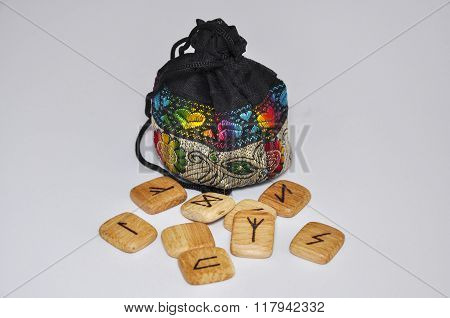 Wooden Runes On A White Background