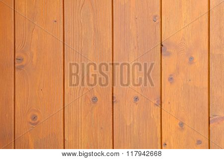 Background of dark wooden wall in yellow brown color with natural wood pattern
