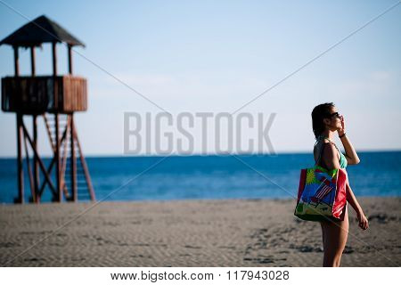 Sexy woman on beach vacation with accessories