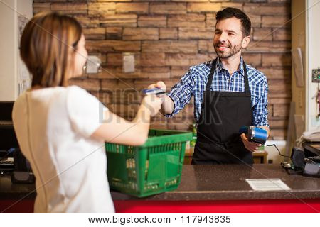 Cashier Receiving A Credit Card Payment