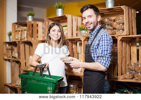 Store Clerk Helping A Customer