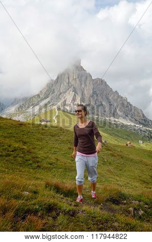 young woman tourist in alpine zone