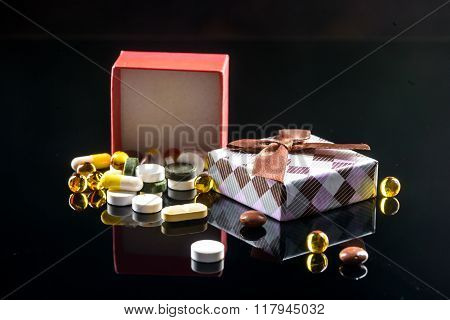 pills and vitamins with gift box