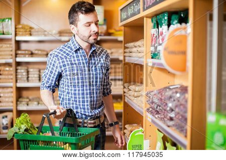 Young Man Buying Some Food At A Store