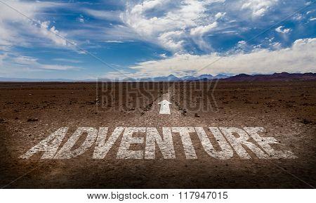 Adventure written on desert road