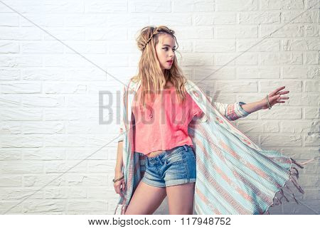 Boho Fashion Girl at White Brick Wall Background