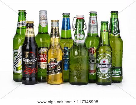 CHISINAU MOLDOVA - December 05 2015: 9 bottles of assorted cold beers. Imported brews including Tuborg Guinness Stella Artoua Miller Bavaria Grolsch Becks Heineken Carlsberg