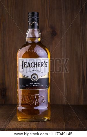 CHISINAU MOLDOVA - FEBRUARY 05 2016: Teacher's Highland Cream Scotch whisky bottle macro isolated on white. Teacher's Highland Cream is a brand of blended scotch whisky produced in Glasgow Scotland.