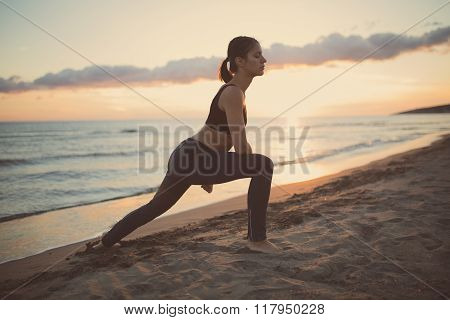 Young fit healthy woman practicing yoga.Healthy lifestyle and regular exercising routine concept