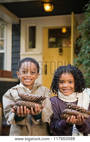 Children with pine cones