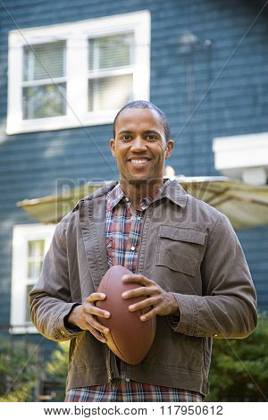 Man holding an American football