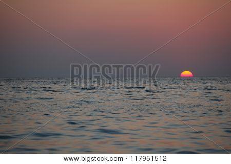 Beautifulk round sun at sunset time over sea