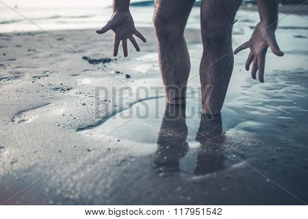 Hopeless man sinking in the quicksand,trying to get out and save himself.Panic and despair,getting trapped in the quicksand.Drowning in problems,failure,and risk tacking concept.