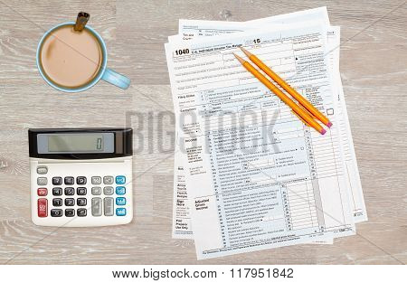 Coffee And Calculator On 2014 Irs Form 1040