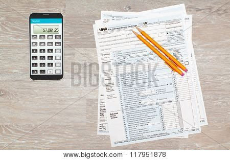 Calculator App On Smartphone With 2015 Irs Form 1040