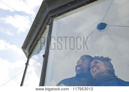 Couple looking out of a window