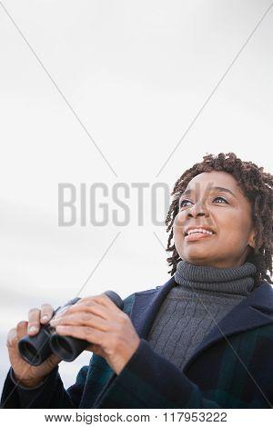 One woman holding binoculars