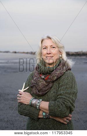 Senior woman holding a starfish