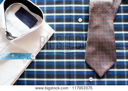 White shirt on chequered background with measuring tape