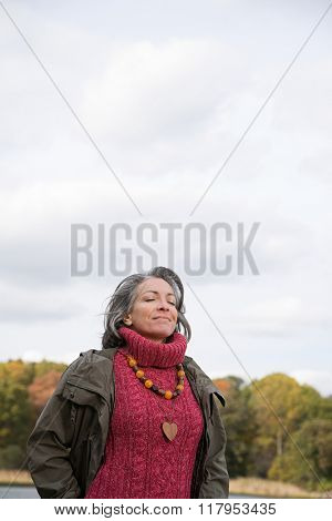 Serene looking mature woman