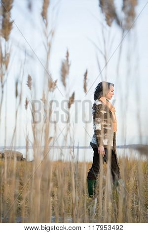 Mature woman walking on marshland