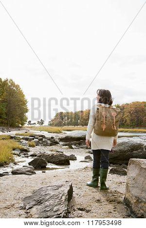 Mature hiker walking over rocks