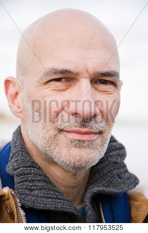 Headshot of a bald man