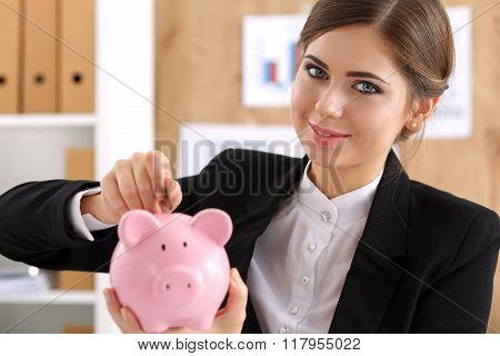 Happy Smiling Beautiful Businesswoman And Piggybank