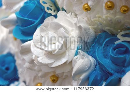 White rose from cream on a wedding cake