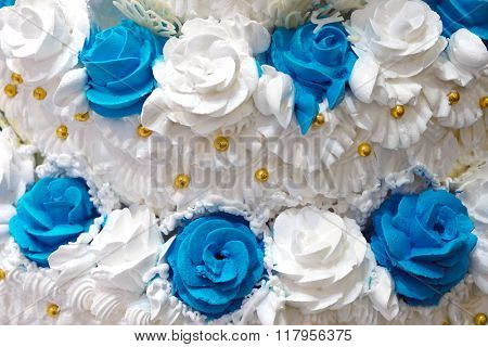Detail of a huge white wedding cake