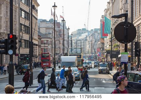 Busy Regent street with transport and walking people