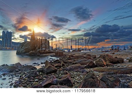 Light House at sea Cove at Sunset , hong kong fishing village