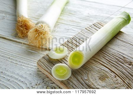 Leeks vegetable raw food with cutted texture in a white wood board table