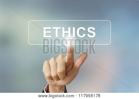 Business Hand Clicking Ethics Button On Blurred Background