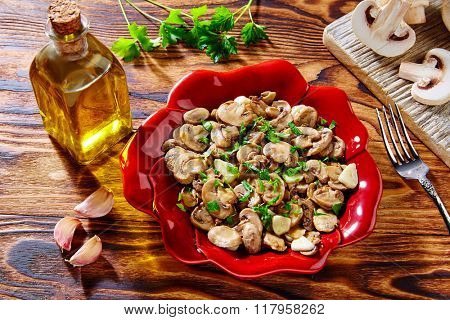 Tapas from Spain champinones garlic mushrooms with potatoes and sausage